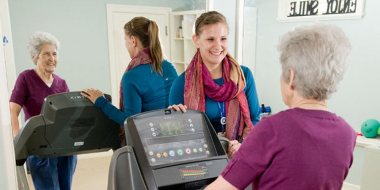 In the gym of the JGH Hope & Cope Wellness Centre, Nikoletta Mallatou's exercise session is supervised by exercise physiologist Lisa Mastroianni.