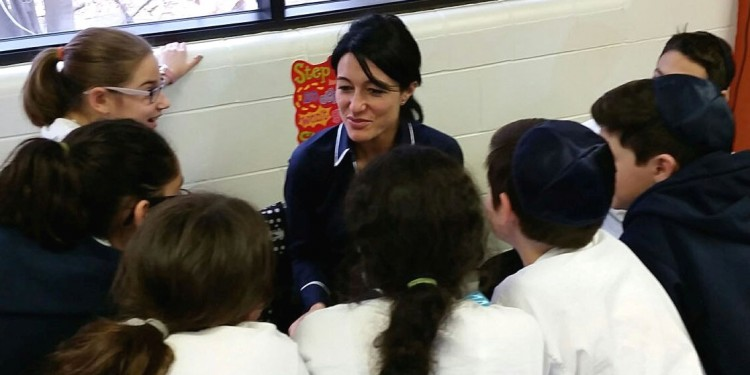 At a session organized by the Jewish Public Library, author/researcher Maria Guzzo meets with secondary students at United Talmud Torah School to talk about emotional expression.