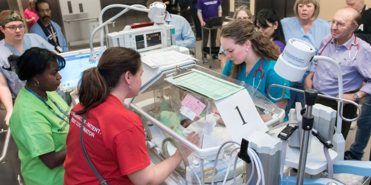 During the move on January 24, an incubator is checked en route to the new Neonatal Intesive Care Unit in Pavilion K, where noise levels and the number of alarms are noticeably lower.
