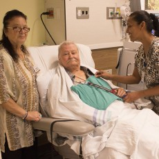 In the new Sandra and Steven Mintz Nephrology Centre, Steve Kakavas receives treatment from Nurse Vashti Kissoon (right), with assistance from his wife, Eugenia, a JGH volunteer.