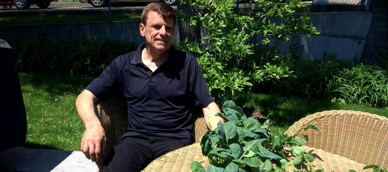Christopher Wrobel relaxes in the green environment that he loves.