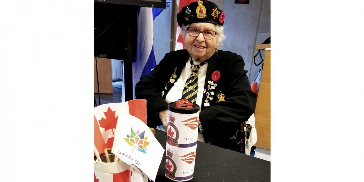 Sandy Bernstein sells Remembrance Day poppies in the main lobby of the JGH.