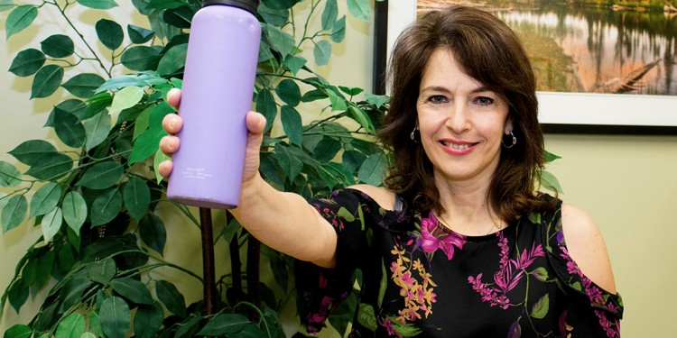 Patricia Urrico raises a bottle of water in a toast to the importance of staying hydrated in winter.