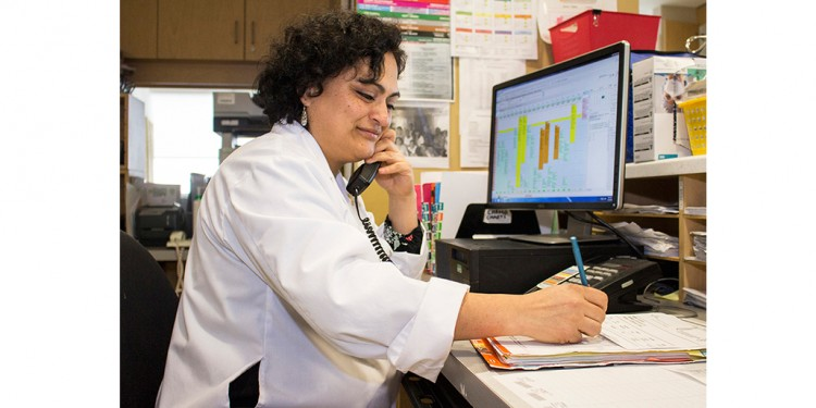 In the Segal Cancer Centre, Nurse Clinician Erika Martinez speaks with a patient who has called the Symptom Management Hotline.