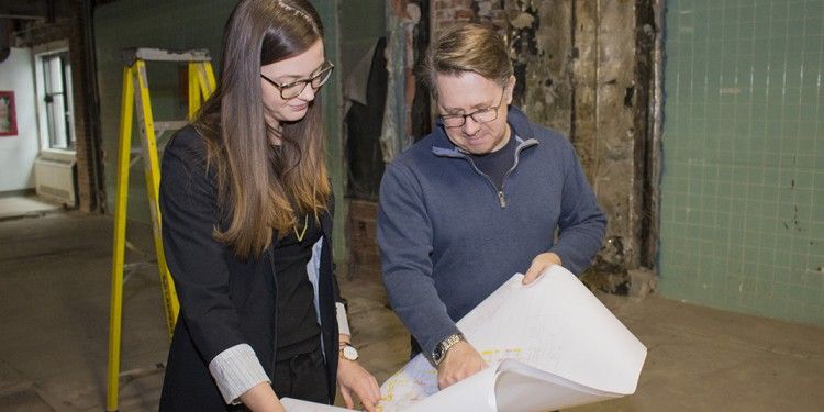 On the third floor of Pavilion B, where the hospital's old operating rooms have been demolished to make way for a new Psychiatry In-Patient Care Unit, JGH Project Manager Julianne Desforges reviews architectural plans with Stéphane Richard, a mechanical technician with SNC Lavelin.
