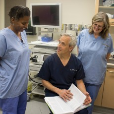 Dr. Gad Friedman reviews aspects of gastroenterology with Endoscopy Nurses Mildred Clement (left) and Joanne Scullion.