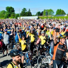 Enthusiastic cyclists gather en masse for the Enbridge Ride to Conquer Cancer.