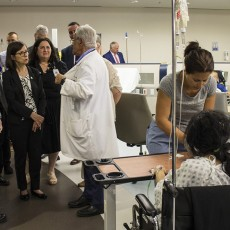 In the JGH Emergency Department, Dr. Marc Afilalo (centre, in lab coat) discusses the activities of the Rapid Assessment Zone with Danielle McCann (centre, in glasses).