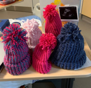 A selection of caps made by patients in The Auxiliary's Ante Partum Program.