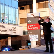 On the sidewalk outside Pavilion K, Cantor Henry Granek blows a kudu shofar, whose sounds are offered as a non-verbal thank-you to healthcare workers fighting the coronavirus.