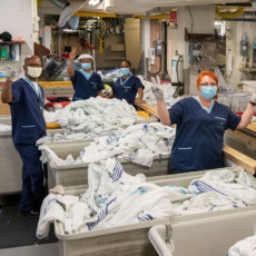 In the JGH Laundry, (from left) Richard Gamble, Hassan Hersi, Onika McIntosh, Marietta Herrera and Linda Klupper are among the employees who are helping the hospital and its patients cope with the COVID-19 pandemic by providing a reliable supply of clean linen, towels, scrubs, gowns, protective clothing and other items.