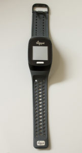 A wristwatch-style telehealth device is used to remotely monitor patients' vital signs.
