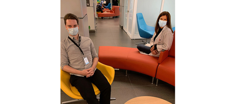 Building Technician David Gadoua and Chloé Décarie-Drolet, Head Nurse in the Post-Partum Unit, sit in the JGH's refurbished lounge. The new breastfeeding room is at right.