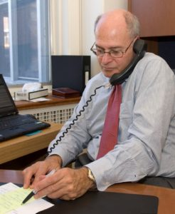 Myer Bick at his desk before his retirement from the JGH Foundation.